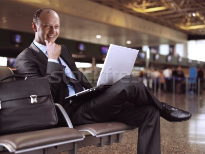 294747_stock-photo-businessman-and-airport